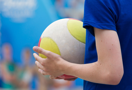 115488657-volleybal-in-the-hands-of-a-child-selective-focus